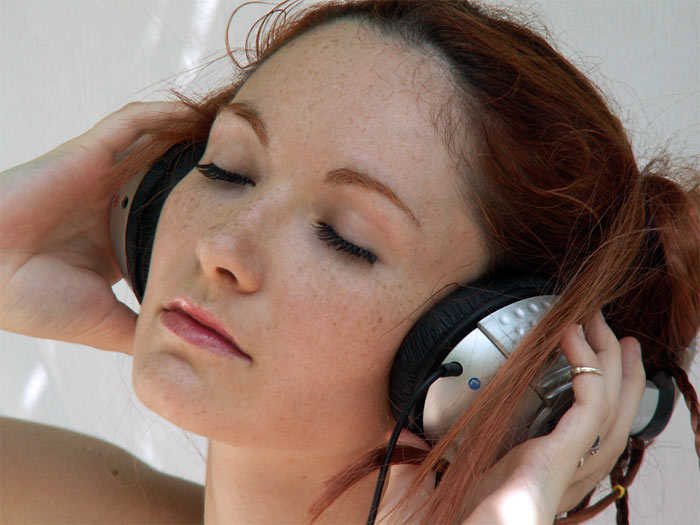 holding-headphones-listening-to-music-3.jpg