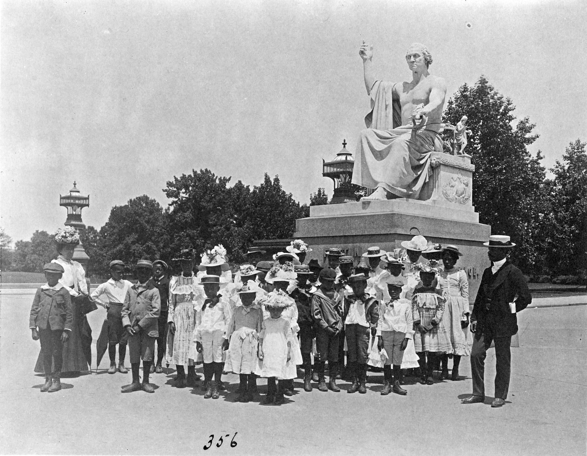 Group of school children in front of statue of George Washington, Washington, D.C.