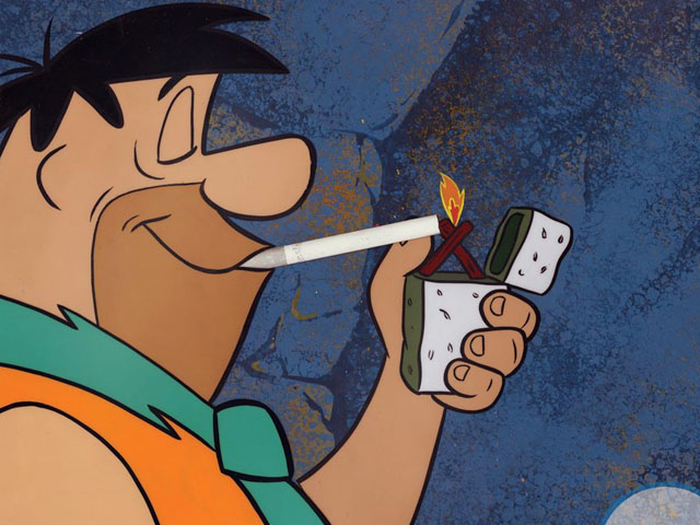 Fred Flintstone smokes a Winston cigarette in a 1960s ad