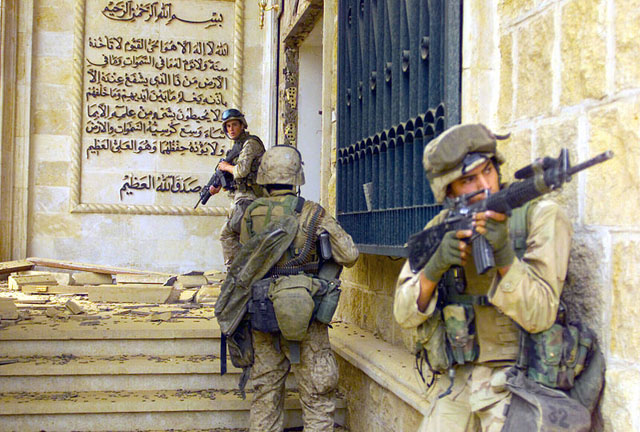U.S. Marines entering one of Saddam Hussein's palaces during Operation Iraqi Freedom, 2003.