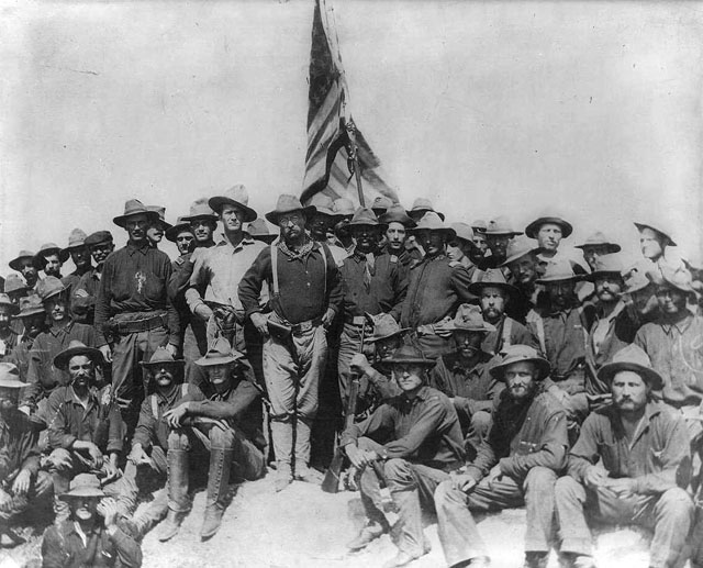 Theodore Roosevelt and the Rough Riders atop San Juan Hill.