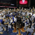 Kansas City Royals pose with World Series trophy after Game 5 of the Major League Baseball World Series against the New York Mets Monday, Nov. 2, 2015, in New York. The Royals won 7-2 to win the series. (AP Photo/Matt Slocum)