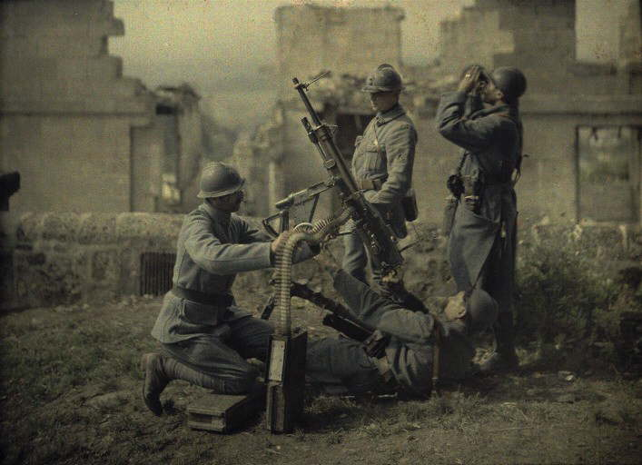 Four French gunners in the ruins