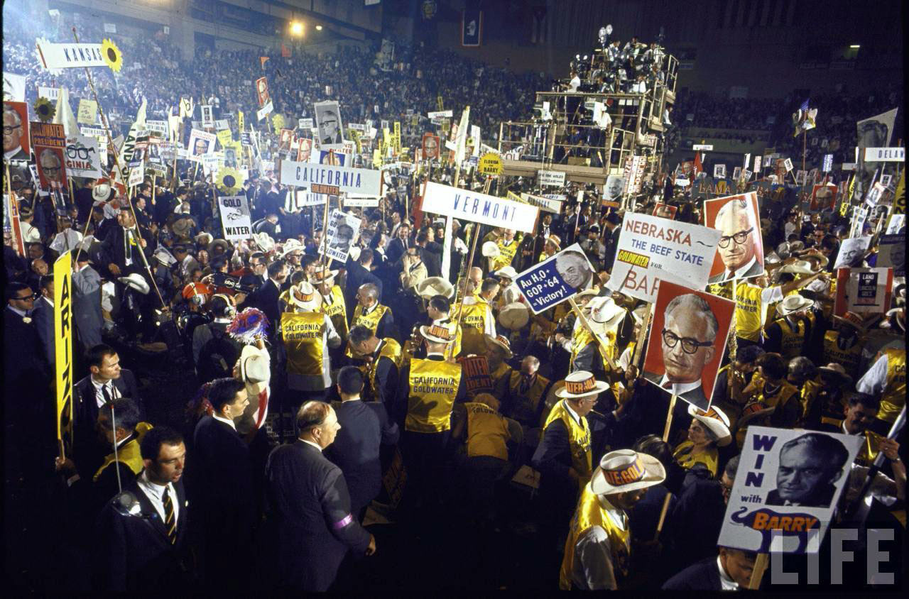 Supporters of Barry Goldwater waving signs at 1964 Republican National Convention.
