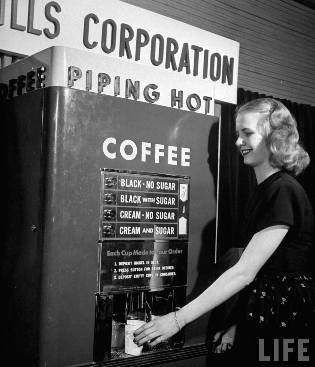 Photograph of a vintage coin-operated coffee machine, 1947