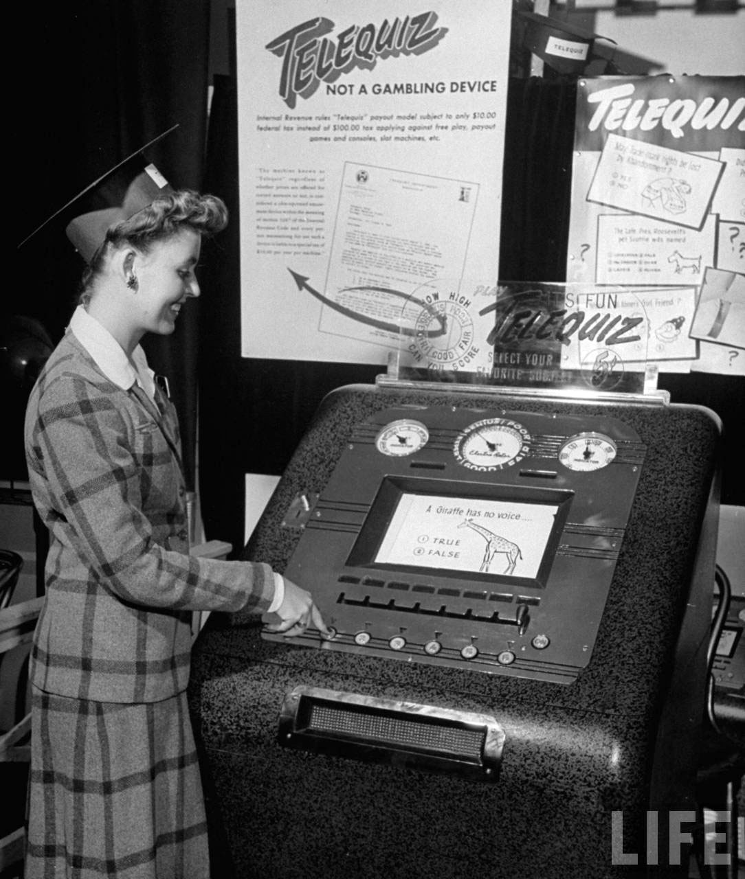 Photograph of a vintage coin-operated quiz machine, 1947 (Life magazine, Wallace Kirkland)