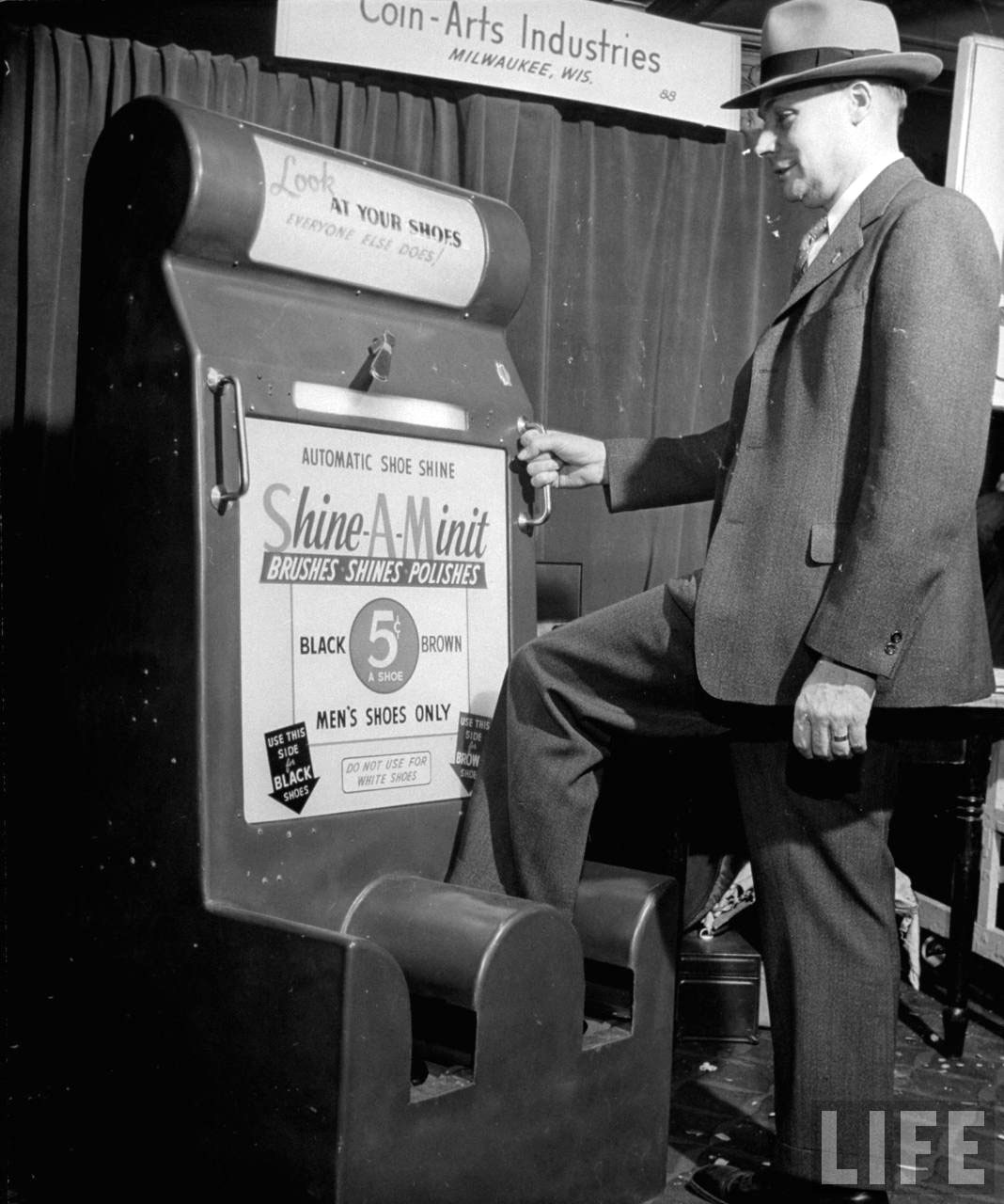 Photograph of a vintage coin-operated shoeshine machine, 1947 (Life magazine, Wallace Kirkland)
